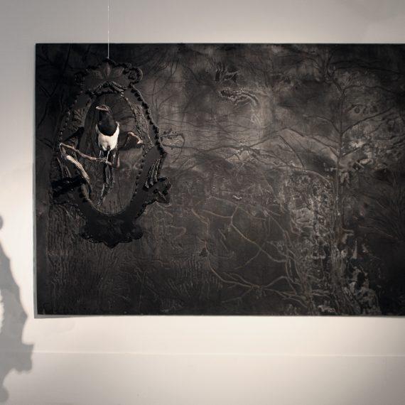 Öinen lehto, 2012, poltettu ja kaiverrettu kierrätysvaneri, 155 x 230 cm